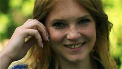 Stock Video Footage of Adorable girl with rosy cheeks smiling to the camera, steadycam shot