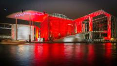 Time lapse Berlin Paul-Löbe-Haus at night with colourful illumination Stock Footage