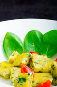Spinach gnocchi with melted butter Stock Photos