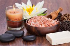 Close-up of spa products with illuminated candles on wooden table Stock Photos