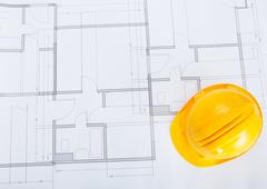 Close-up of blue print and hard hat Stock Photos