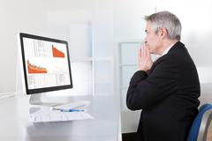 confused businessman with computer - stock photo