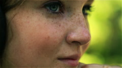 Girl looking to the camera and flirting, closeup, steadycam shot Stock Footage
