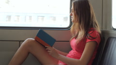 Young Woman Start Reading Ebook Reader On Train HD Stock Footage