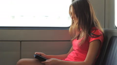 Young Girl Reading Ebook Reader On Train HD Stock Footage
