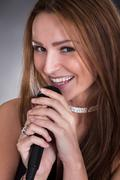young female singer - stock photo