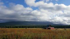 4K Clouds Building over Meadow and Barn Stock Footage