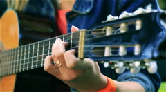 Woman playing on the guitar, steadycam shot Stock Footage
