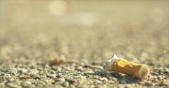 Cigarette Butt Litter Close up Rack Focus Slowly Stock Footage