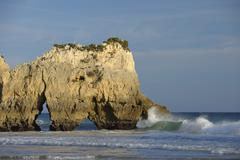 Natural Arch Rock Formations at Praia dos Tres Irmaos and Atlantic Ocean, Alvor, - stock photo