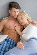 Romantic Lovers on Bed Fashion Shoot Stock Photos