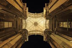 Looking up at Arco da Rua Augusta Illuminated at Night, Praca do Comercio, - stock photo