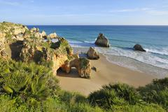 Rock Formations at Praia dos Tres Irmaos and Atlantic Ocean, Alvor Portimao, - stock photo