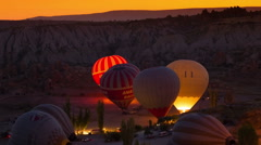 GOREME - OCTOBER 12 (TIME-LAPSE): Colorful hot air balloons inflating before the Stock Footage