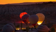 Stock Video Footage of GOREME - OCTOBER 12 (TIME-LAPSE): Colorful hot air balloons inflating before the