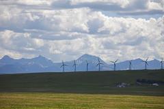 Wind generators in field, mountain range in background, Montana, USA Kuvituskuvat