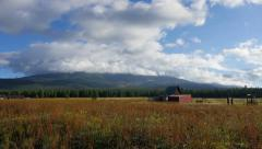 Clouds Building over Meadow and Barn Stock Footage