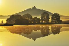 Wachsenburg Castle with Morning Mist reflecting in Lake at Dawn, Drei Gleichen, Stock Photos