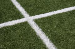 White lines intersecting on grass Stock Photos