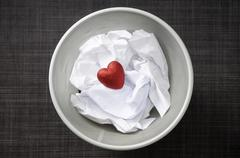 Heart shaped decoration with cruled paper in wastebasket Stock Photos