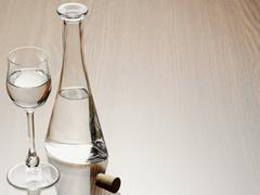 Glass of Grappa with Carafe and Cork, Studio Shot Stock Photos