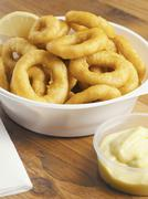 Fried calamari in bowl with condiment Stock Photos