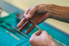 using a scalpel - stock photo