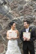 Portrait of Married Couple with Mr and Mrs Signs - stock photo