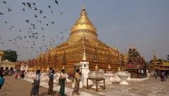 People Walking Around Shwezigon Pagoda in Nyaung-U, Bagan, Myanmar (Burma) Stock Footage