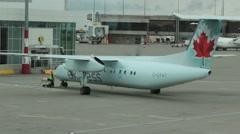 Air Canada Dash 8-300 Aircraft Refuels at Terminal  Stock Footage