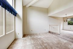 Empy house interior with high vaulted ceiling and carpet floor Stock Photos