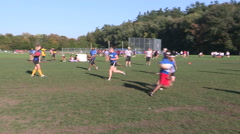 College and university students quidditch games on campus in autumn Stock Footage