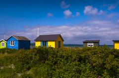 Field and Beach Huts, Aeroskobing, Aero Island, Jutland Peninsula, Region Stock Photos