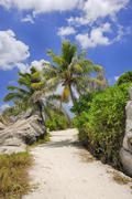Footpath through Rocks and Palm Trees, Anse Source d´Argent, La Digue, Stock Photos