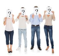 group of a people holding question mark sign - stock photo