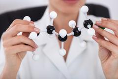 Scientist looking at molecular structure Stock Photos