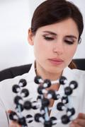 scientist looking at molecular structure - stock photo