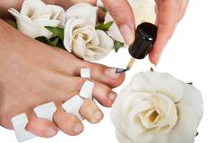 pedicure treatment for woman's feet - stock photo