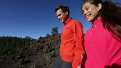 Hiking couple romantic holding hands on Tenerife Stock Footage