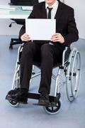 Handicapped businessman holding paper Stock Photos