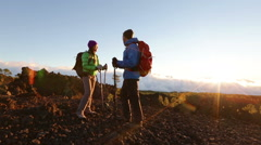 Travelers in hiking clothing traveling on trek Stock Footage