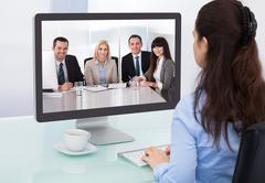 Businesswoman watching video conference Kuvituskuvat