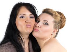Image of joking bride and bridesmade - stock photo