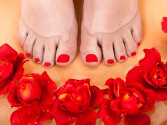 Female feet getting aroma therapy Stock Photos