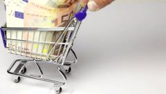 Euro banknotes in a shopping cart Stock Footage