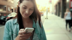Pretty caucasian woman texting on her mobile device. - stock footage