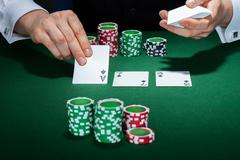 Croupier arranging cards Stock Photos