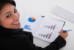 Businesswoman studying graph Stock Photos