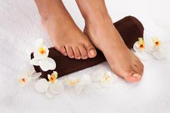 close-up of human foot getting aroma therapy - stock photo
