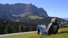 Reading in the Dolomites Alps Stock Footage